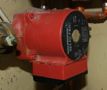 Photo of a Grundfos Selectric domestic central heating circulating pump wrongly installed with the electrical control box underneath