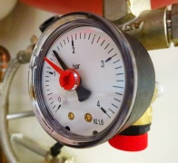 Dial gauge reading pressure in a sealed central heating system