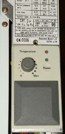 Photo of an early Potterton Suprima control with a membrane over the reset button on the PCB. The membrane had to be pressed to reset the boiler. This complet control panel is changed when a new Potterton Suprima circuit board is fitted.